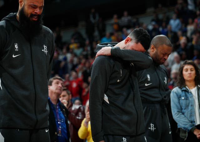 Houston Rockets centre Tyson Chandler, guard Austin Rivers and forward P.J. Tucker reacted during a tribute