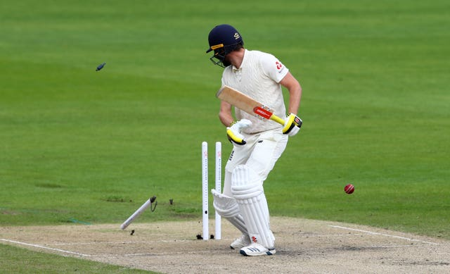 England's Chris Woakes is bowled out by West Indies' Kemar Roach