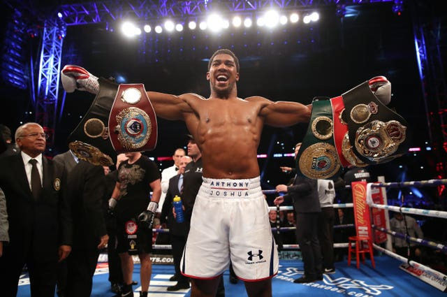 Anthony Joshua retained his belts