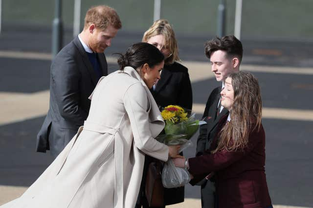 Meghan Markle received flowers outside the Eikon Exhibition Centre in Lisburn (Brian Lawless/PA)
