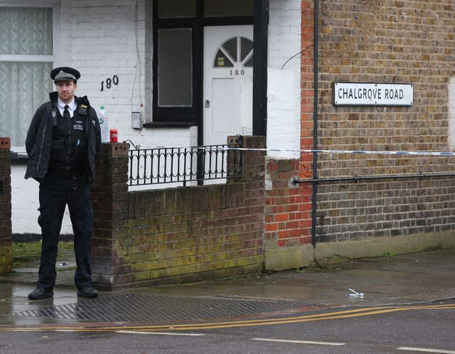 A police officer near the scene of the Tottenham shooting (Jonathan Brady/PA)