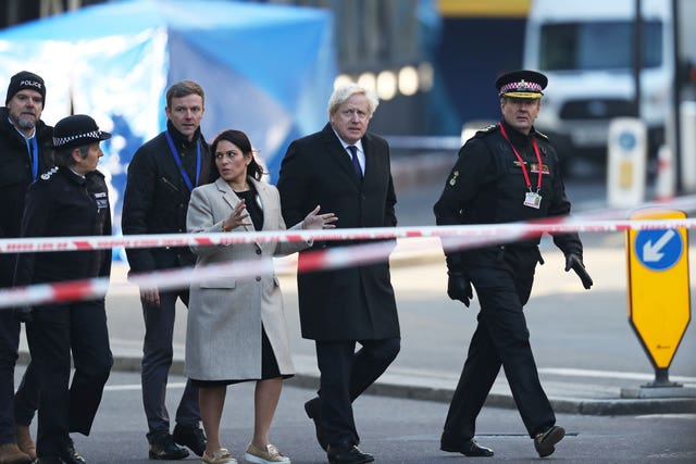 Mr Johnson pictured during a visit to the scene (Steve Parsons/PA)