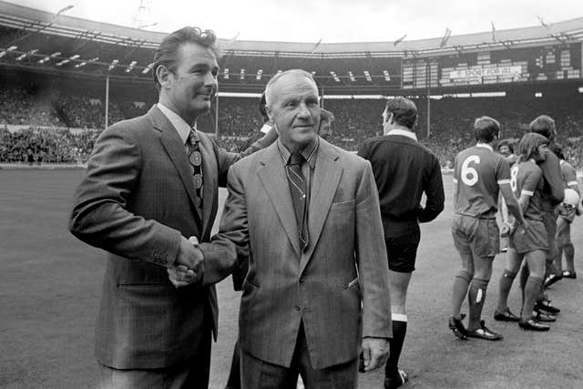 Clough (left), pictured with Liverpool manager Bill Shankly, made a big impression on the English game