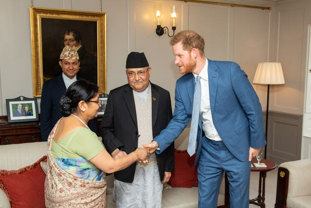 Harry with the Nepalese Prime Minister and his wife