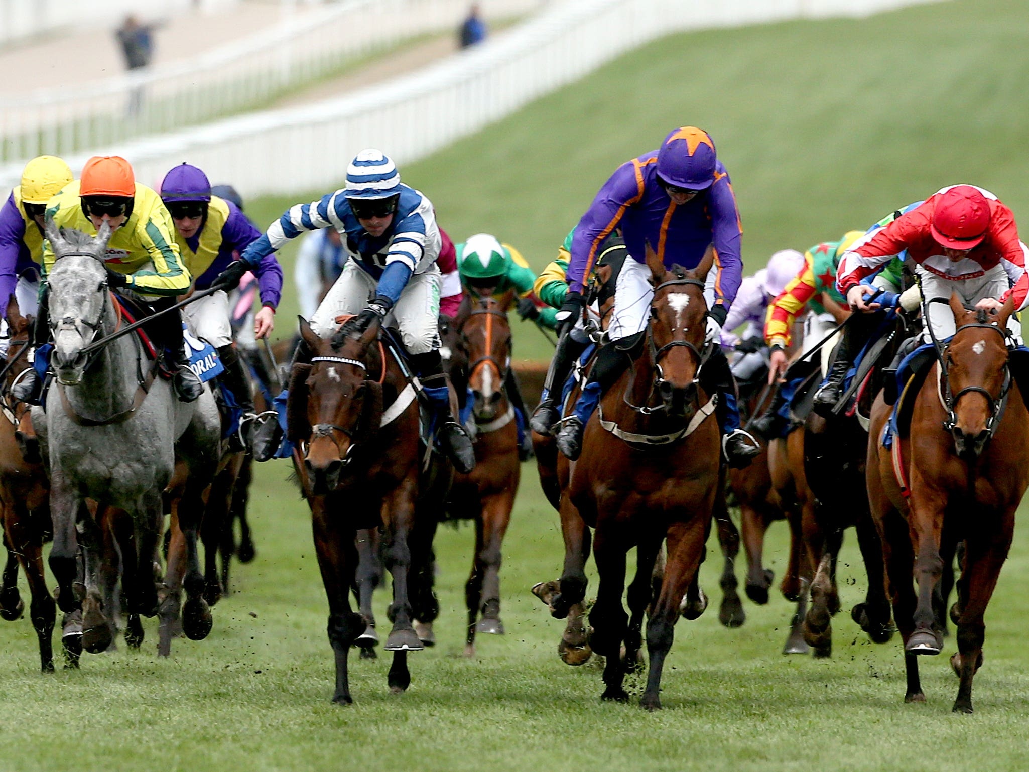William Henry (blue and white) flashes home to win the Coral Cup (Paul Harding/PA)