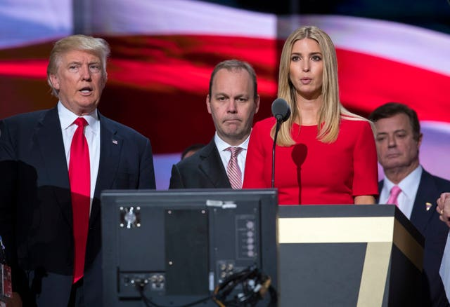Gates and Manafort stand behind Trump and daughter Ivanka