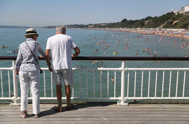 A couple look out from Bournemouth Pier
