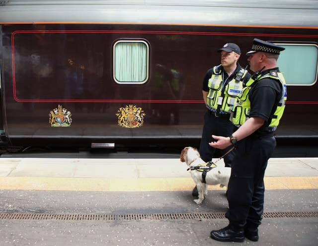 Police stand by the Royal Train