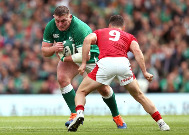 Ireland's Tadhg Furlong (left) and Wales' Tomos Williams battle for the ball