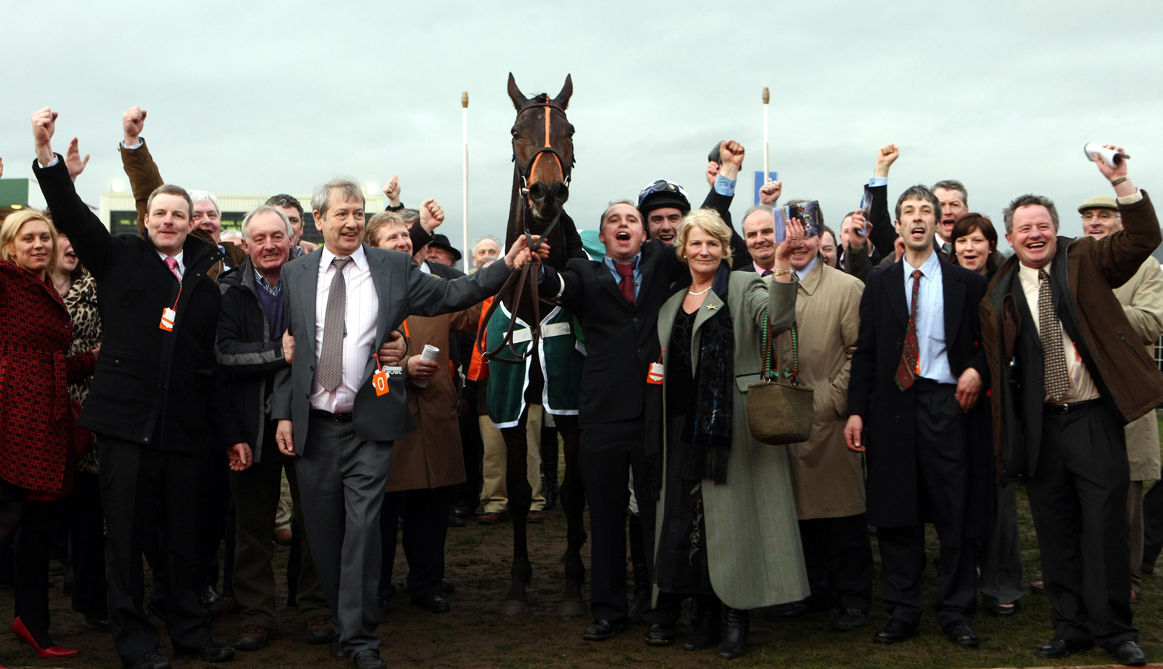 Connections of Dunguib celebrate after winning the Champion Bumper at Cheltenham in 2009