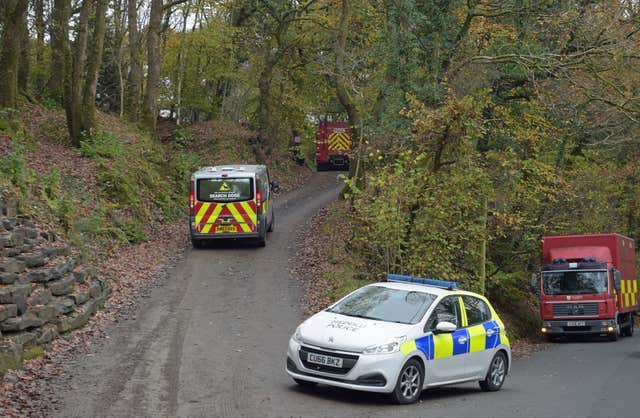 A police search dogs van drives towards the scene (Ben Birchall/PA)