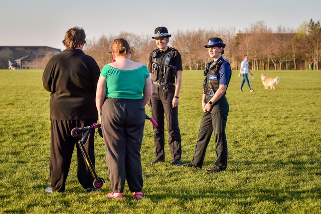Police chat to people in a park