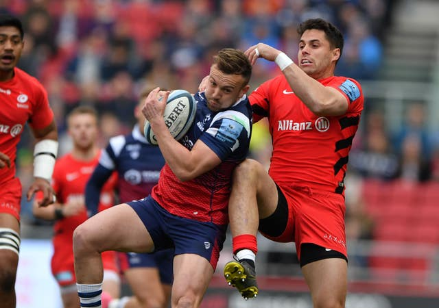 Bristol Bears' Andy Uren and Saracens Sean Maitland battle for the ball as Bristol beat Saracens 23-21