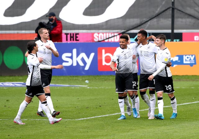 Morgan Whittaker (second right) is congratulated by his team-mates after scoring against Derby