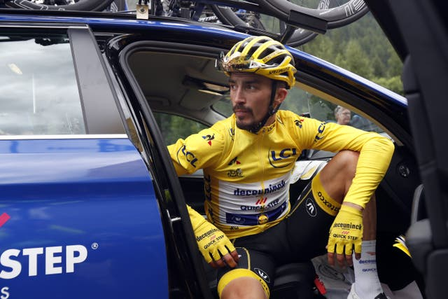 A dejected Julian Alaphilippe sits in a team car