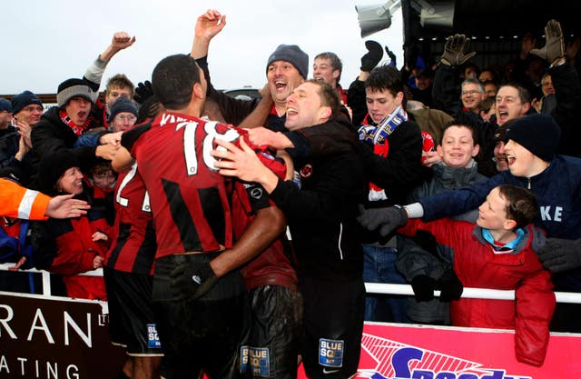 Histon's players and fans celebrated a famous FA Cup victory over Leeds in 2008