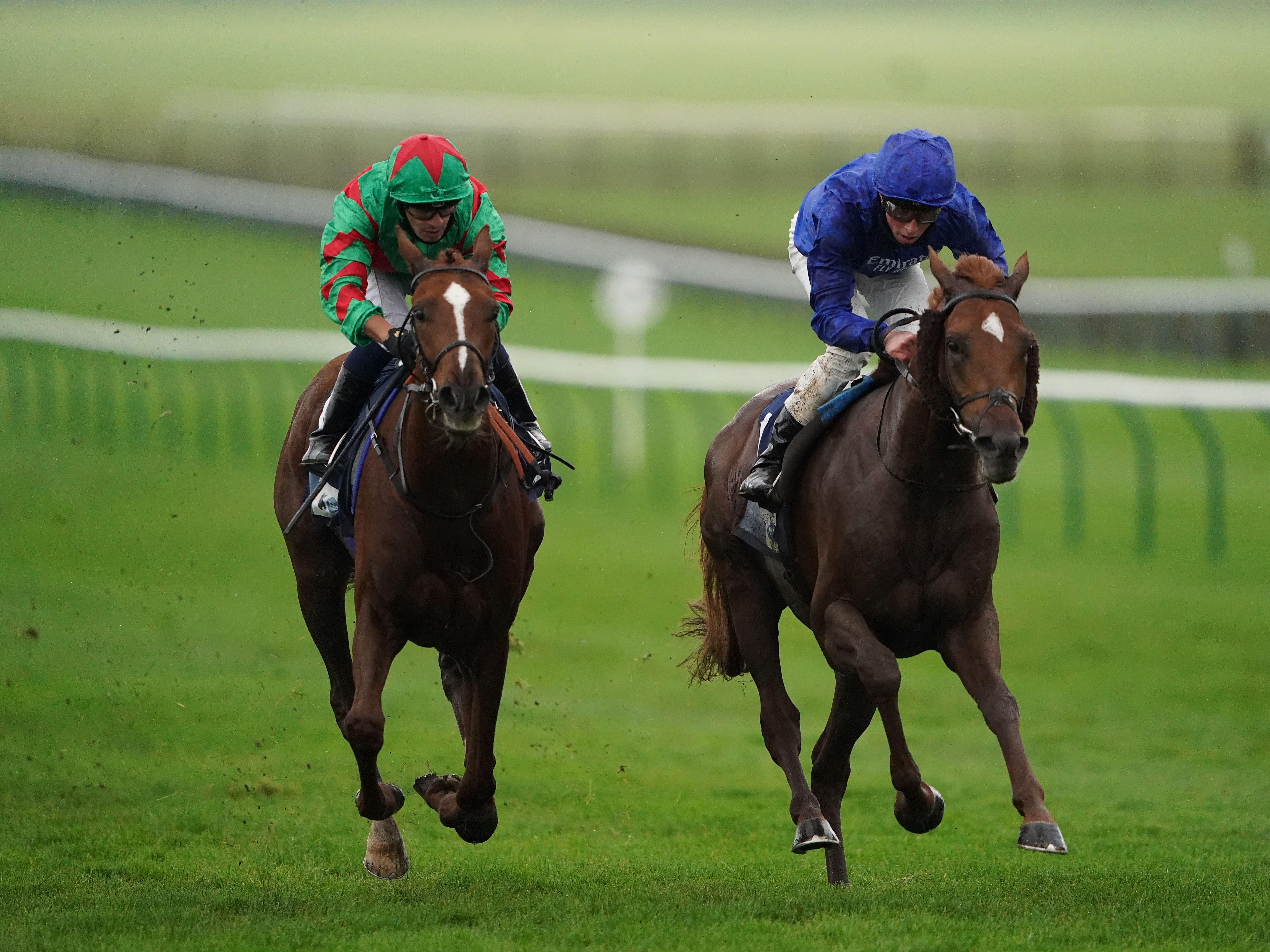Act Of Wisdom (right) on the way to victory at Newmarket (Tim Goode/PA)