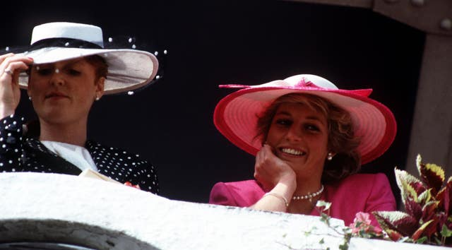 The Duchess of York and the Princess of Wales in the Royal Box at Epsom for the Derby in 1987 (PA)