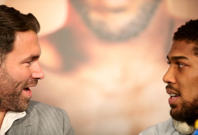 Boxing promoter Eddie Hearn, left, will be looking to seal a good deal for Anthony Joshua