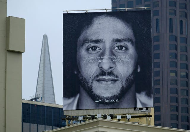 A billboard on top of a Nike store showing Colin Kaepernick