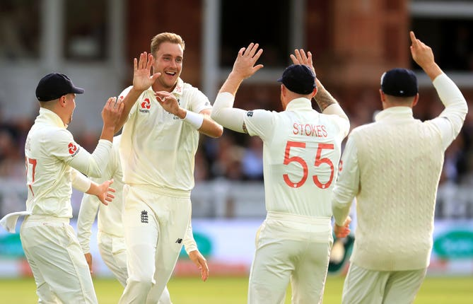 Stuart Broad celebrates with his team-mates after removing David Warner at Lord's