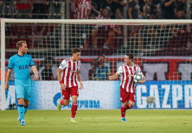 Olympiacos' Daniel Podence, right, celebrates his goal