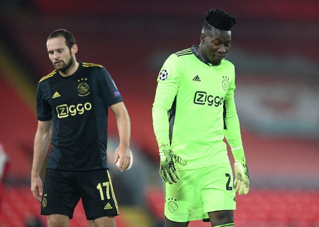 Andre Onana, right, shows his frustration
