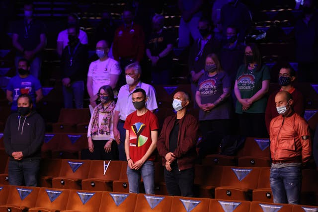Spectators wearing face masks observed a minutes' silence in memory of the Duke of Edinburgh during the Betfred World Snooker Championships 2021 at The Crucible, Sheffield