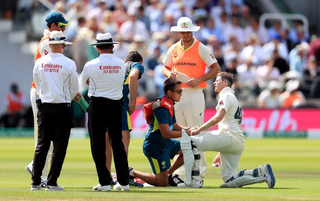 Steve Smith receives treatment to his arm after a brutal Jofra Archer delivery