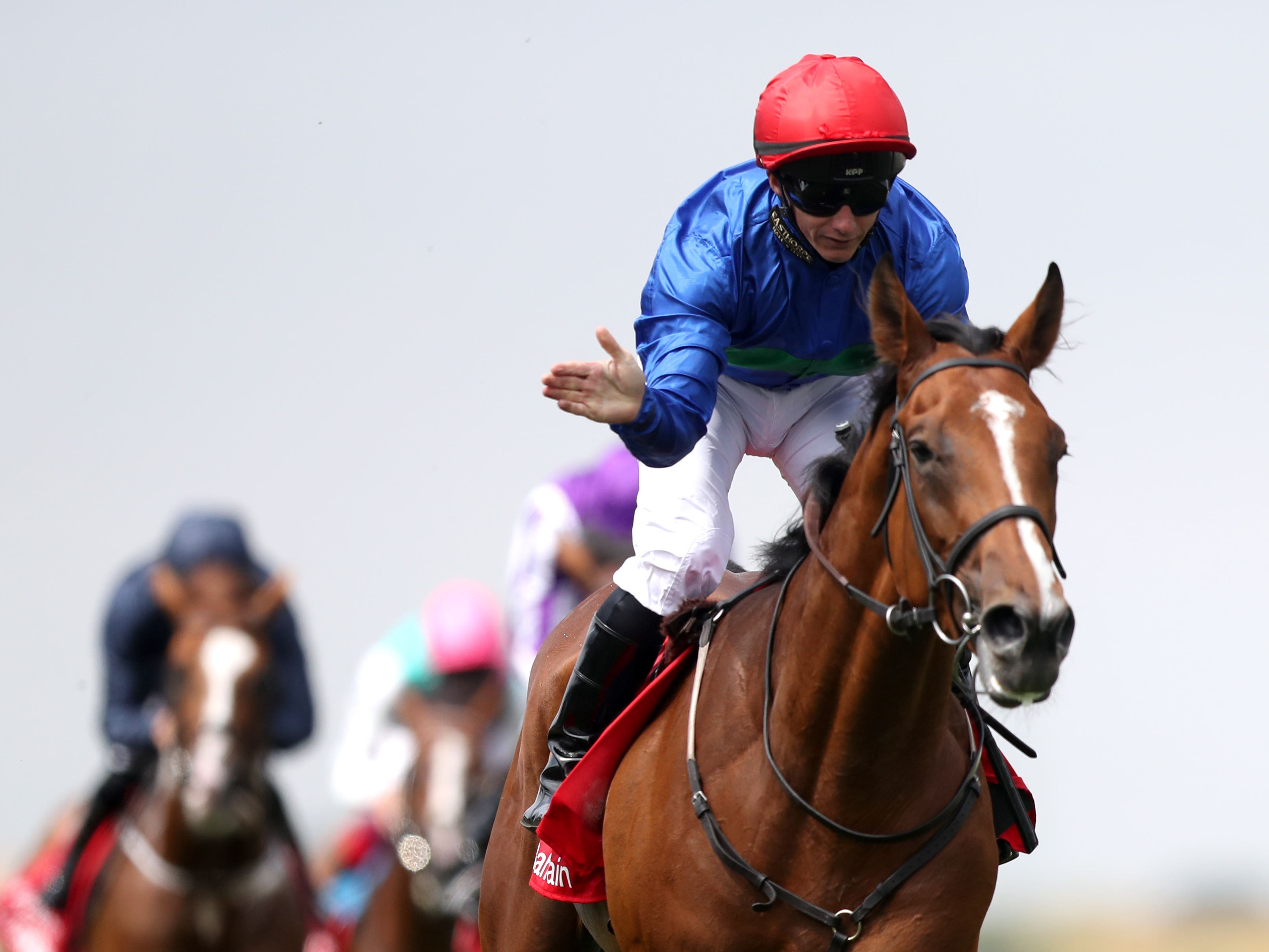 David Allan pats Wells Farhh Go after their victory in the Bahrain Trophy Stakes at Newmarket (Simon Cooper/PA)
