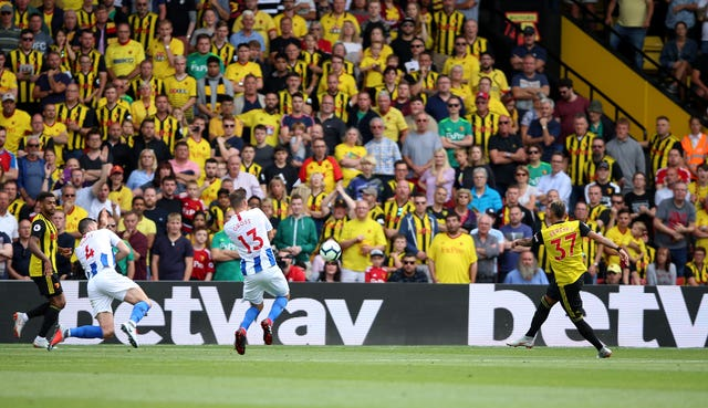 Roberto Pereyra, right, scores the first of his two goals against Brighton in last season's opener