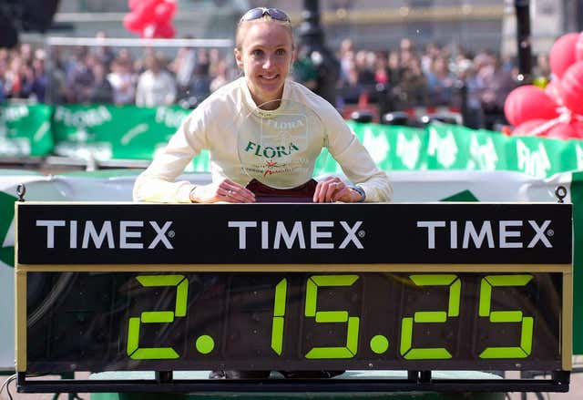 Paula Radcliffe poses with her world record time