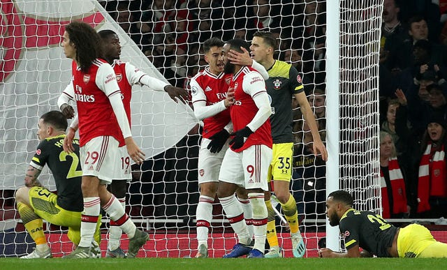 Alexandre Lacazette (9) celebrates scoring the Gunners' last-gasp equaliser