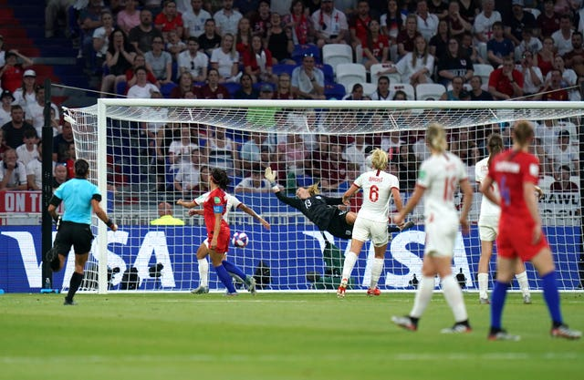 Morgan, red - left, heads USA back in front at 31st minute