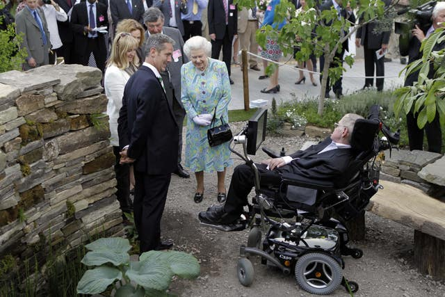 The Queen with Stephen Hawking as she visits gardens at the RHS Chelsea Flower Show, at the Royal Hospital, Chelsea, London (PA)