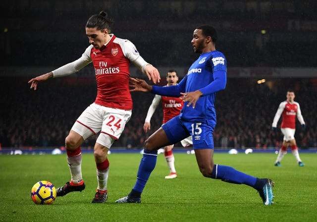 Arsenal's Hector Bellerin and Everton's Cuco Martina battle for the ball during a Premier League match