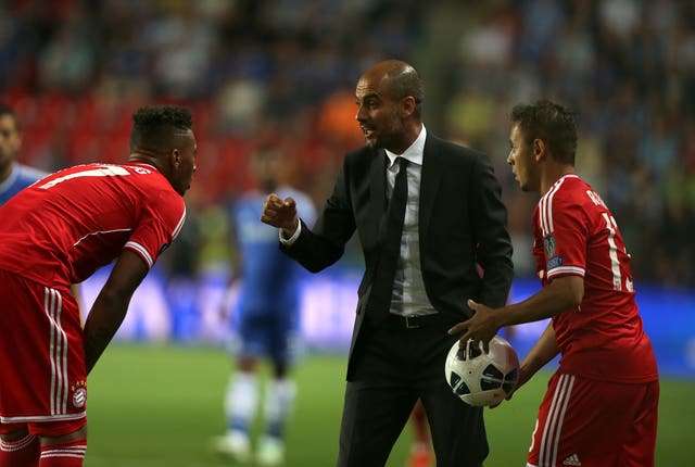 Bayern Munich manager Pep Guardiola (centre). (PA)