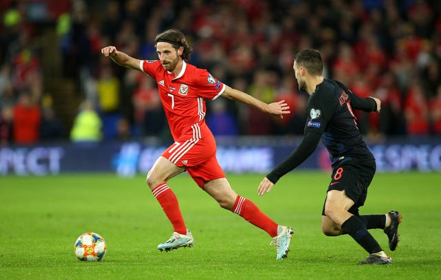 A booking for Joe Allen means he will not feature in Azerbaijan