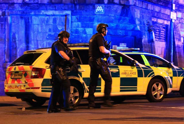 Armed police at Manchester Arena after the suicide bombing which killed 22 people (Peter Byrne/PA)