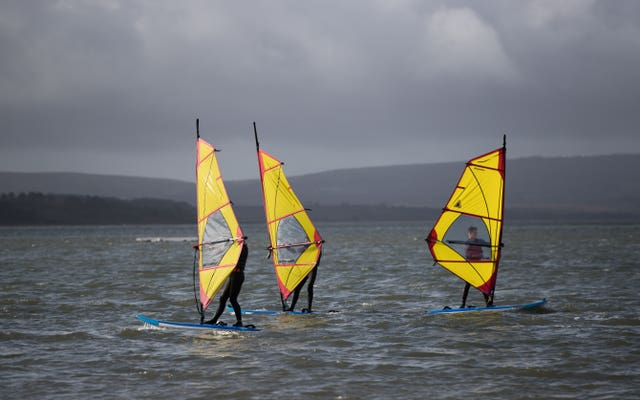 These windsurfers took advantage of the stormy conditions on the Rock Lea river near to Poole in Dorset