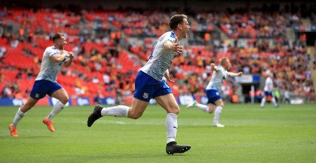 Connor Jennings wheels away in delight after netting the winner at Wembley