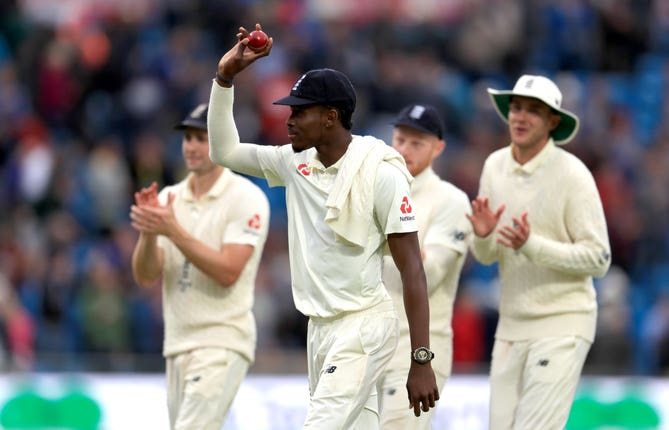 Jofra Archer is applauded by his England team-mates after his six-wicket haul