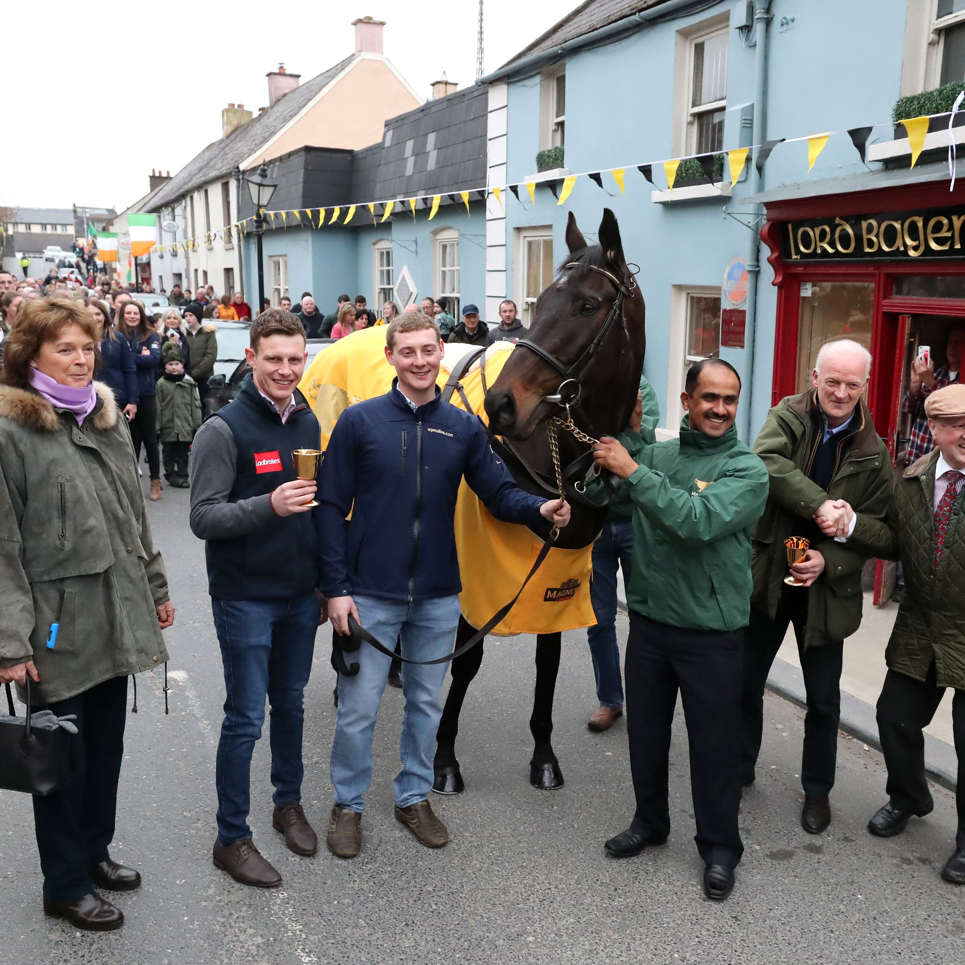 Cheltenham Gold Cup winner Al Boum Photo with jockey Paul Townend (second left) and trainer Willie Mullins (second right) during the homecoming parade through Leighlinbridge, County Carlow