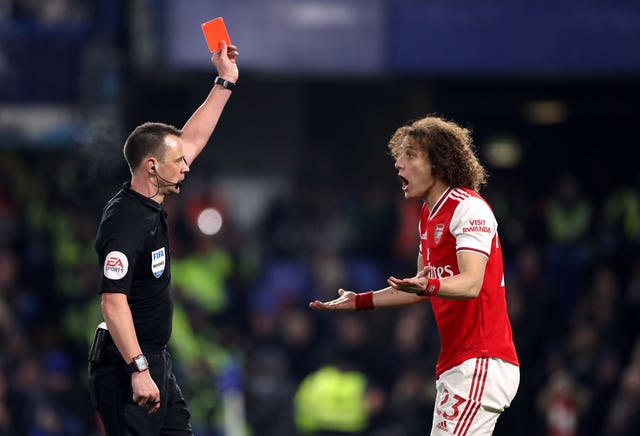 Arsenal battled for a point at Chelsea after David Luiz was sent off