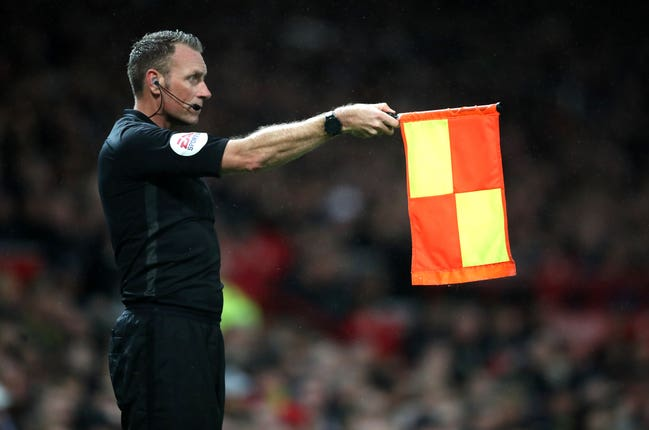 Linesman xxx flags for offside