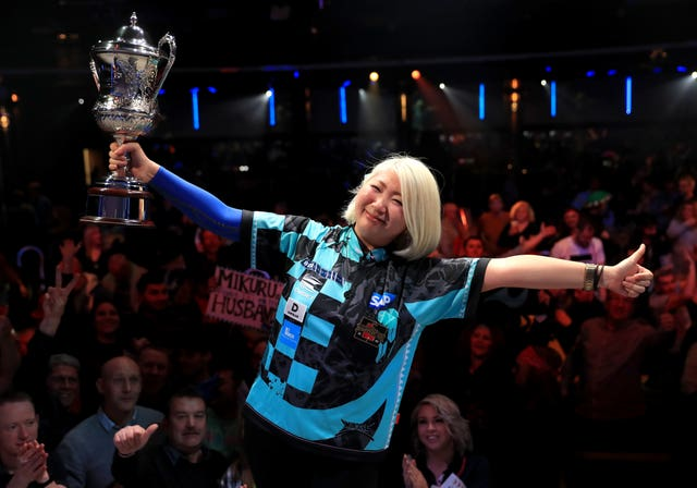 Mikuru Suzuki celebrates winning the women's championship during day eight of the BDO World Professional Darts Championships