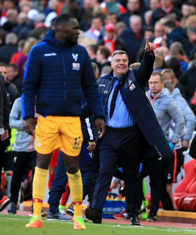 Sam Allardyce celebrates after Christian Benteke, left, earned Crystal Palace victory at Anfield