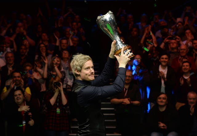 Neil Robertson celebrates with the UK Championship trophy