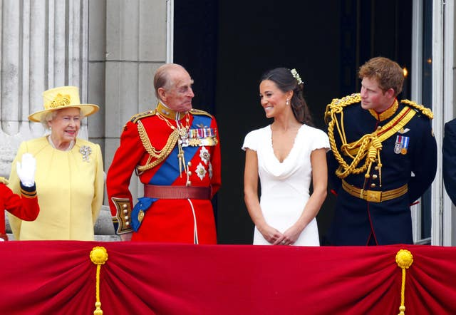The Queen in yellow, the Duke of Edinburgh, Pippa Middleton and Prince Harry on the Palace balcony after William and Kate's wedding (Chris Ison/PA)