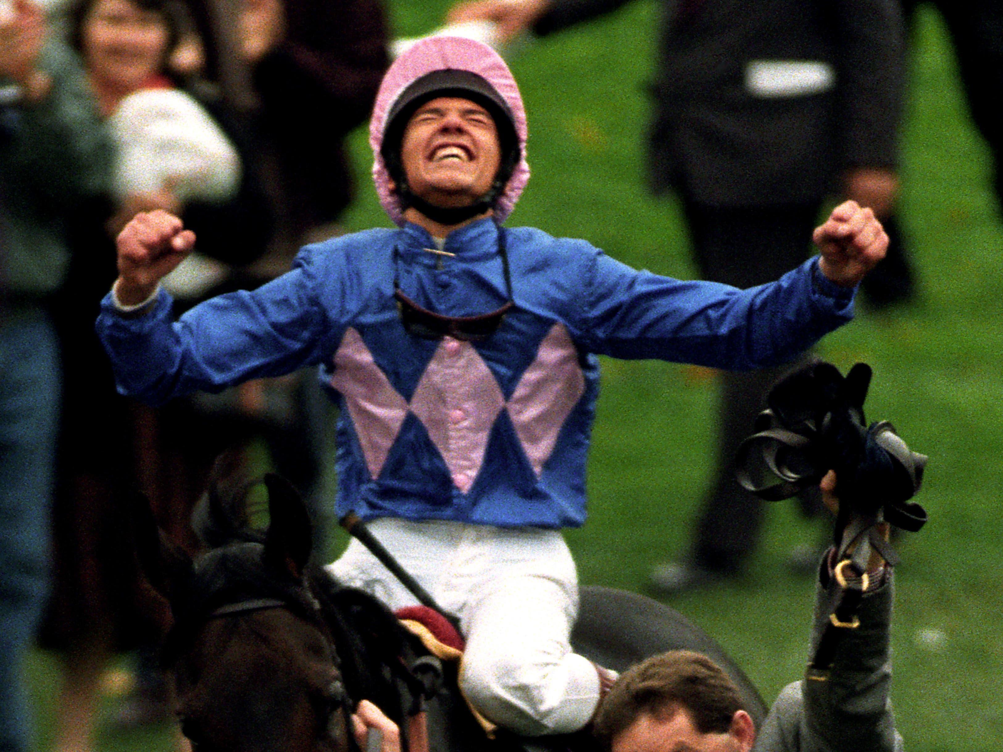 Frankie Dettori celebrates on Fujiyama Crest, the last leg of his 'Magnificent Seven' (Adam Butler/PA)